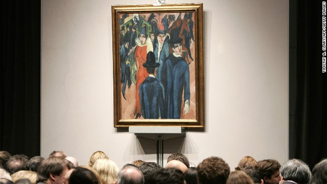 "Buyers look at Ernst Ludwig Kirchner's ""Berliner Strassenszene"" (""Berlin street scene"") during a New York sale. Thousands of artworks condemned as ""degenerate"" by the Nazis were confiscated in the 1930s and 1940s. The restitution of this painting prompted fears that Germany could lose countless pieces found to have been taken from their rightful owners."