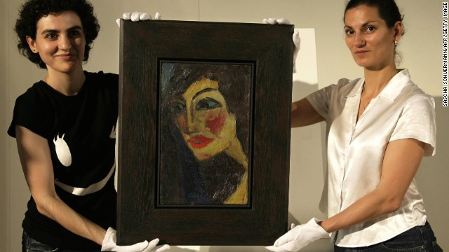 "Auction assistants hold German expressionist painter Emil Nolde's portrait ""Nadja,"" in Munich in 2007. The picture, which was considered missing for decades, was found in an attic in Germany. Works by Nolde were among those rediscovered in Munich in 2012."