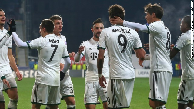 Bayern Munich's players celebrate Mario Mandzukic's goal against Viktoria Plzen to break the deadlock in the Czech Republic.