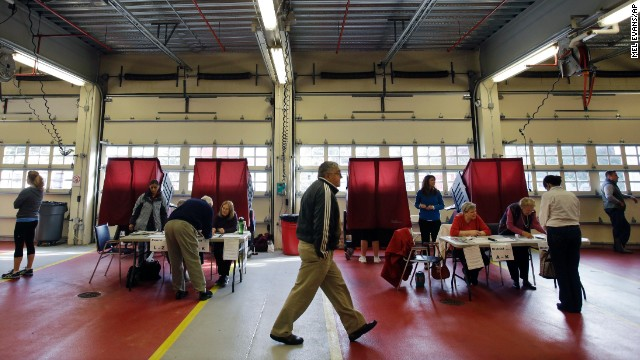 Poll workers help voters cast their ballots in Mendham Township, New Jersey.
