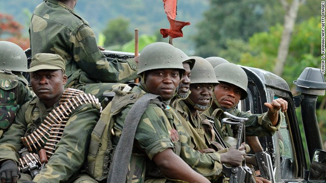 Military successes in the Democratic Republic of Congo have led the M23 militia group to announce its intention to disarm.<!-- --></br>Pictured, army soldiers head towards the Mbuzi hilltop, near Rutshuru, on November 4, 2013, after the army recaptured the area from M23.
