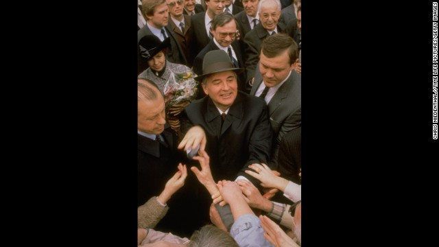 Gorbachev greets well-wishers during a visit to Prague in 1987.