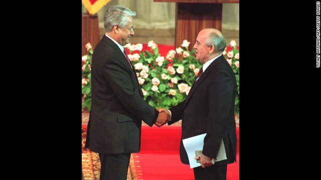 Gorbachev shakes hands with Yeltsin after Yeltsin's investiture as Russian president in Moscow in 1991.