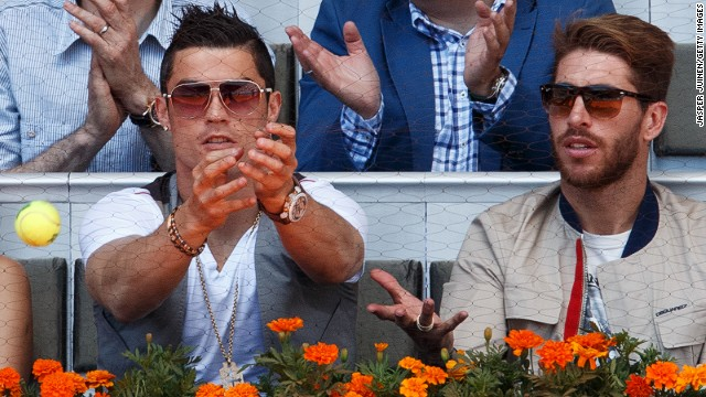 Real Madrid soccer stars Cristiano Ronaldo and Sergio Ramos watch Nadal beat compatriot David Ferrer, despite being just two points from defeat in their Madrid Open quarterfinal. Nadal would go on to beat Swiss Stanislas Wawrinka in his seventh consecutive final since his comeback.
