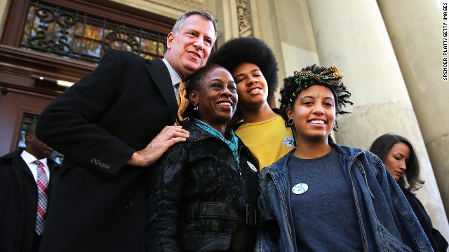 Left to right, New York Mayor-elect Bill de Blasio poses wife Chirlane McCray, son Dante and daughter Chiara, after voting.