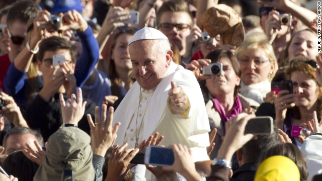 Pope Francis gives the thumbs up to pilgrims at St. Peter's Square.