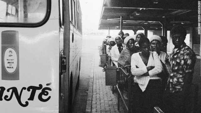 5:40 am: Passengers wait to board local buses at Marabastad terminal in Pretoria en route to work for the day. Because of racial segregation, many were forced to travel up to eight hours a day to get to and from work in the city.