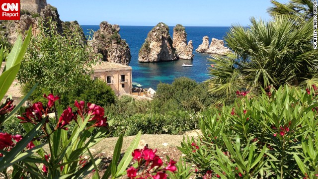 """I hesitate to share this photo because it really does feel like a secret jewel of a place,"" says Angelo Greco of this corner of Sicily. ""The water is crystalline and the rock formations protruding from the Mediterranean are stunning."""