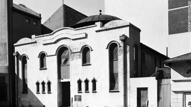 """The churches in this country, the synagogues, the mosques, all of them are particular, abundantly expressive of the people who built them,"" says Goldblatt. Pictured is the Poswhol Synagogue, Johannesburg, as shot by Goldblatt in 1975."