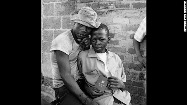 "Photographed in November 1972 in Soweto, two young men show their ""dompas"" -- an identity document that every Afric"