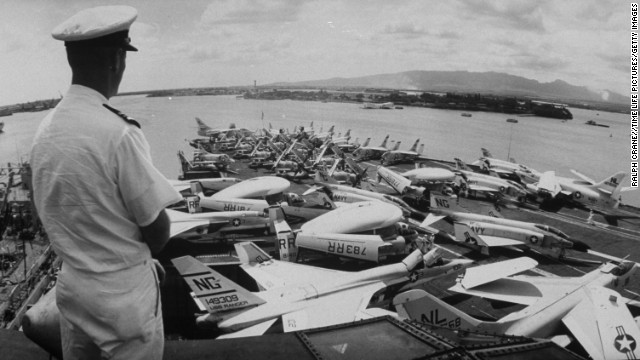 A man looks over the flight deck of the USS Ranger in Pearl Harbor in 1964. The Ranger was the first ship to be designed and built as an aircraft carrier from the beginning. It was the only ship in its class.