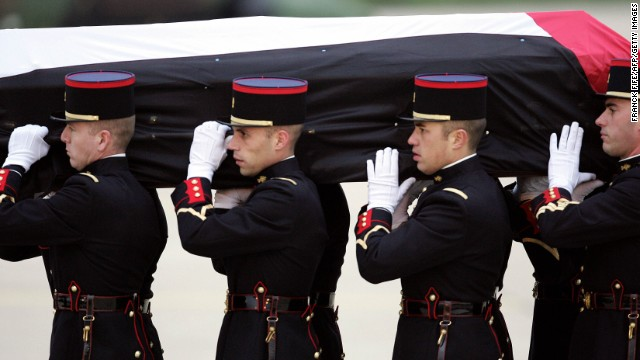French Republican Guards transport Arafat's body to a military airport on November 11, 2004. Arafat died in a Paris hospital that day at the age of 75. The cause of his death has been disputed.