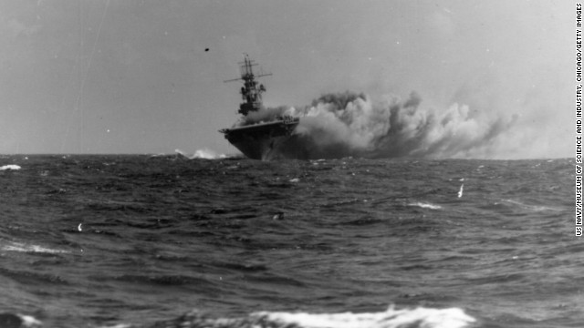 The USS Wasp burns in the Coral Sea after being struck by three torpedoes from a Japanese submarine in 1942. The ship, the only one of its class, would eventually sink because of the damage.