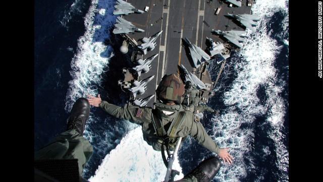 Aircrew members are lifted from the flight deck of the USS John F. Kennedy during an exercise in 2002. The ship, which was decommissioned in 2007, was the only member of its class.