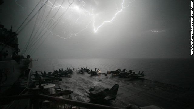 Lightning strikes over the flight deck of the USS John C. Stennis, another Nimitz-class aircraft carrier, as the ship moves through the Persian Gulf in 2007. All of the Navy's 10 active aircraft carriers are from the Nimitz class, which started in 1975 with the commission of the USS Nimitz.