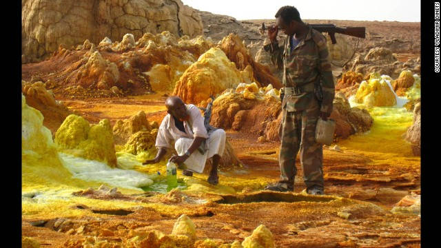 Perhaps the world's hottest place, Dinets found Afar a place difficult and dangerous to travel through. His assistants in Afar are shown here collecting volcanic acid.