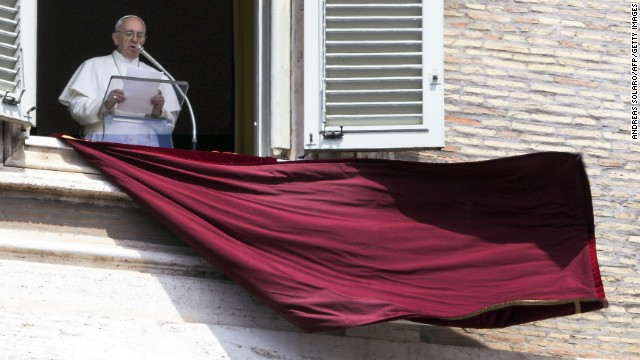 Pope Francis delivers his speech from the window of his apartment during his Sunday Angelus prayer in St. Peter's Square at the Vatican on April 21.