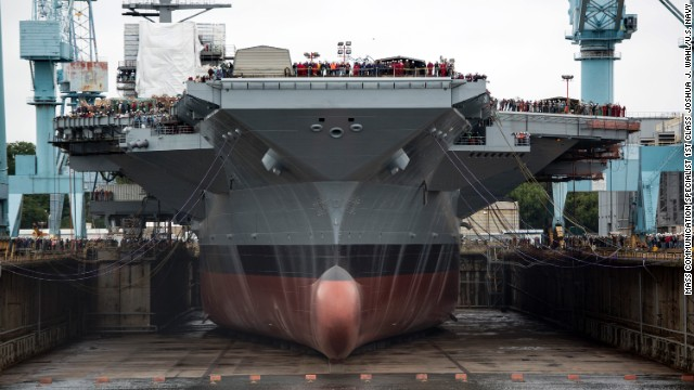 Shipbuilders in Newport News, Virginia, prepare to flood a dry dock, on Saturday, November 9, 2013, to float what will be the USS Gerald R. Ford, the first ship in the U.S. Navy's newest class of aircraft carriers.