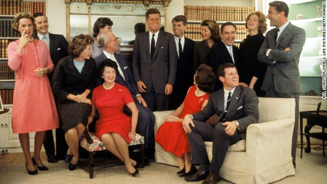 The night after John F. Kennedy won the 1960 presidential election this family portrait was made in Hyannis Port, Massachusetts, on November 9, 1960. Sitting, from left, Eunice Shriver (on chair arm), Rose Kennedy, Joseph Kennedy, Jacqueline Kennedy, head turned away from camera, and Ted Kennedy. Back row, from left, Ethel Kennedy, Stephen Smith, Jean Smith, President John F. Kennedy, Robert F. Kennedy, Pat Lawford, Sargent Shriver, Joan Kennedy, and Peter Lawford.