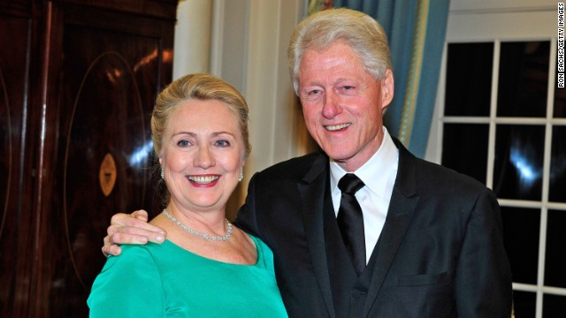 Secretary of State Hillary Clinton and former President Bill Clinton attend a dinner for Kennedy honorees at the Department of State in Washington on December 1, 2012.