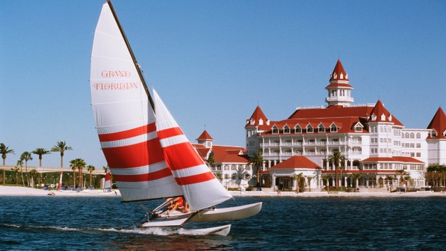Disney's Grand Floridian Resort in Lake Buena Vista features family friendly suites, a walk-in pool with a waterfall and after-dark kids' activities.