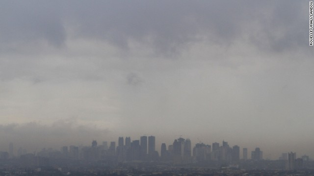 Dark clouds brought by Haiyan loom over Manila skyscrapers on November 8.