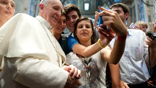 On August 28, Pope Francis and Italian teens take what is likely the first papal selfie.