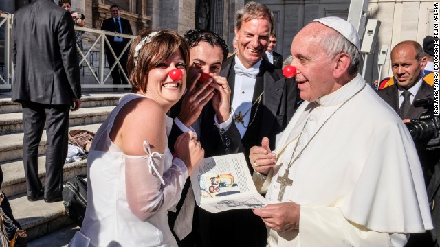 Pope Francis jokes with members of the Rainbow Association on November 6. The group uses clown therapy in hospitals, nursing homes and orphanages.