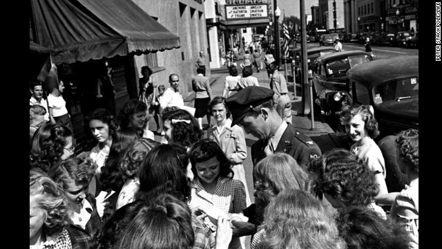 The movie star and war vet signs autographs for local girls in his hometown of Indiana, Pennsylvania.