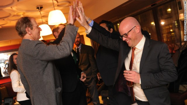Rick Ridder, left, high-fives Christian Sederberg at a victory party in downtown Denver. Advocates for Proposition AA celebrated on Tuesday, November 5, after The Associated Press and the Denver Post called the vote in their favor. Proposition AA would impose a pair of taxes on legal marijuana sales.