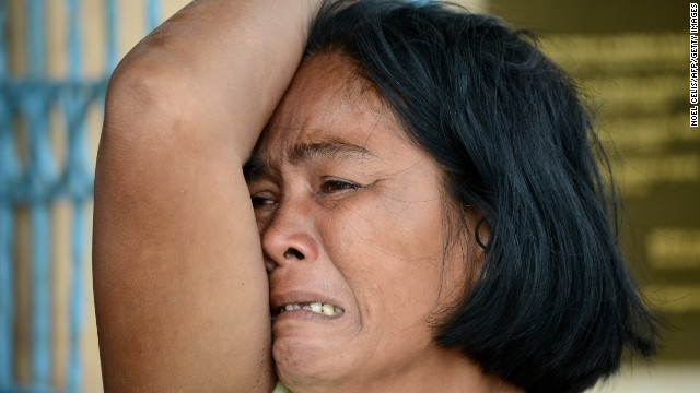 A woman mourns her dead son at a chapel in the aftermath of Super Typhoon Haiyan in Tacloban, eastern island of Leyte on November 9, 2013.