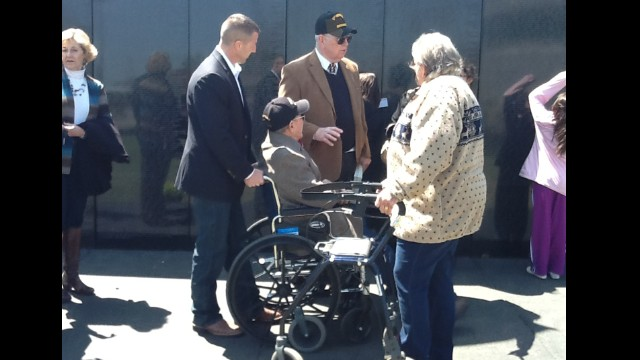 "Kenneth ""Cowboy"" Morris, a veteran of the 300th Engineer Combat Battalion, is pushed by his grandson, U.S. Rep. Markwayne Mullin."