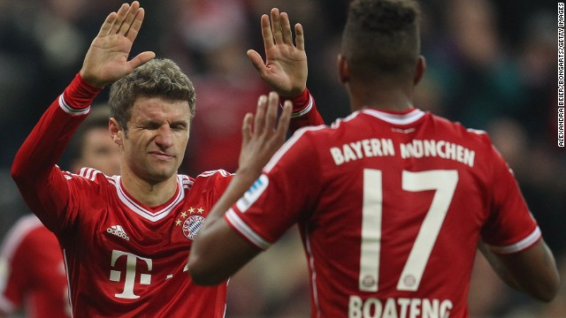 Thomas Mueller (L) celebrates scoring Bayern Munich's third goal with Jerome Boateng who also scored in the 3-0 win.