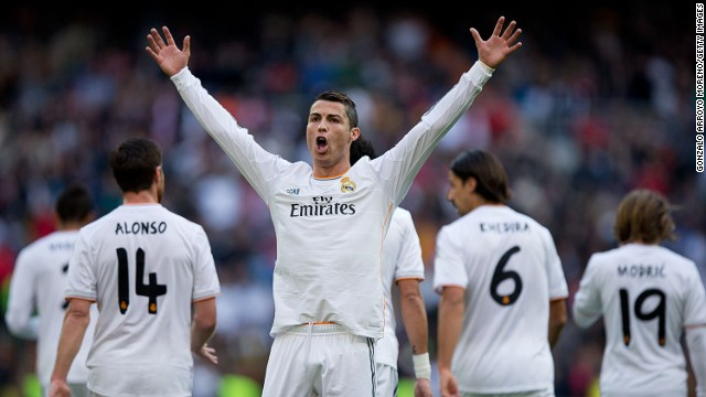 Cristiano Ronaldo milks the applause after scoring the opening goal in the 5-1 thrashing of Real Sociedad.