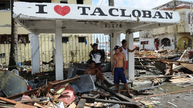 People stand under a shelter in Tacloban.