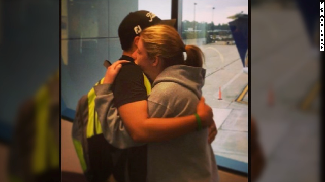 Brad Holden, 18, and his girlfriend, Kenzie Elliott, 17, embrace as Holden prepares to move from Michigan to Florida for college. The photo was taken at an airport in Michigan, but Holden posted it to Instagram at the Atlanta airport while waiting for his flight to Florida.