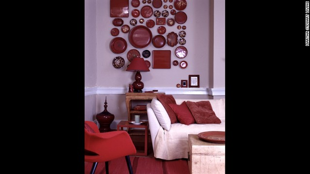 An assortment of lacquered plates and trays creates a bold display in a<!-- --> </br>living room. <!-- --> </br>
