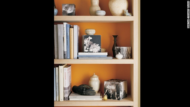 Paint the backs of bookcases in vibrant colors or just line them with<!-- --> </br>colored paper.<!-- --> </br>