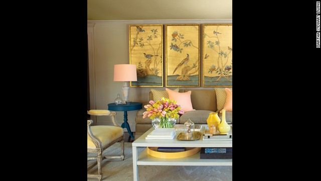 The hues of Asian panels bring a beige room to life.