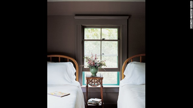 A guest bedroom at Martha's home on Lily Pond Lane In East Hampton, New York, painted in a soothing gray-brown.
