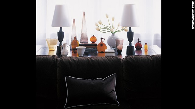 Against white walls, a bittersweet chocolate brown sofa has the impact of black without the harshness.
