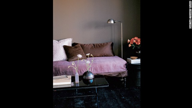 Mauve, lavender and lilac fabrics enhance and uplift dusky taupe walls.