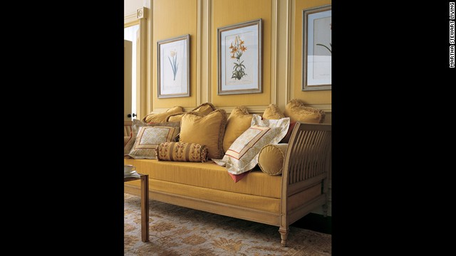 On this daybed, opulent fabrics and a rich palette of burnt red, deep gold, and pale cream and gold create a sense of depth.<!-- --> </br>