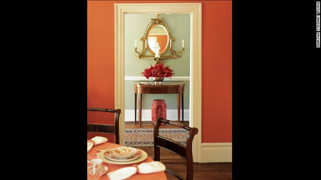 Coppery-red warms a cool-gray hallway.