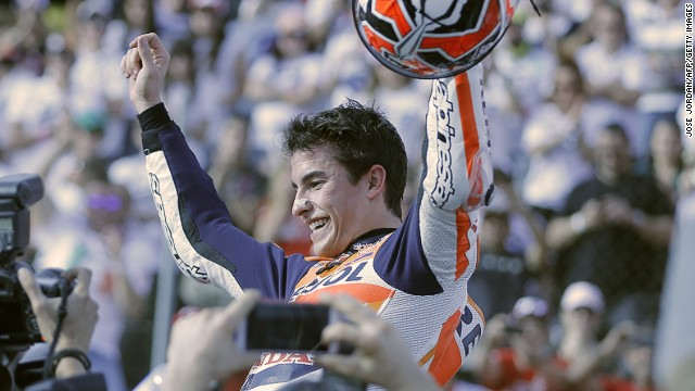 Marc Marquez is hoisted aloft after claiming the MotoGP title. The 20-year-old Spaniard is the youngest rider ever to win the world championship.