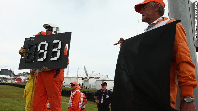 Race marshalls show Marquez the black flag at the Australian GP in October. The Honda rider was disqualified for exceeding the maximum number of laps allowed before a driver must complete a pit stop. Lorenzo took the checkered flag to keep his title chances alive.