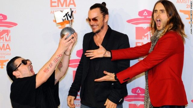 Members of U.S. rock band Thirty Seconds to Mars -- Tomo Milicevic (from left), Shannon Leto and Jared Leto -- pose with their award for best alternative song.