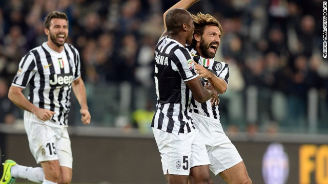 Andrea Pirlo (right) celebrates scoring Juventus' second goal against Napoli on Sunday.