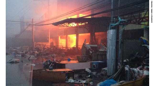 Soon after Super Typhoon Haiyan hit Tacloban, desperate shop owners tried to extinguish fires that broke out in buildings with small buckets of water, storm chaser James Reynolds said.