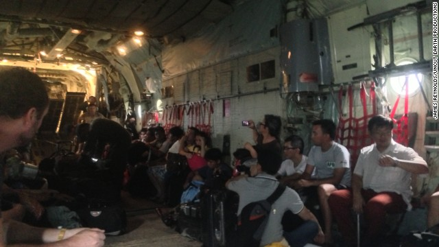 The storm chasers only managed to board the flight after catching a helicopter from a military staging post to Tacloban airport. The roads had been blocked by debris, turning the airport from a short drive away into a potential seven-hour trek.